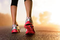Runner feet sunrise Royalty Free Stock Photo