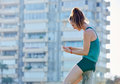 Runner girl having a rest and using smartphone Royalty Free Stock Photo