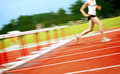 Runner in a hurdle race Stock Photography