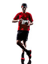 Runner jogger digital tablets ipad silhouette one young man using in isolated on white background Stock Images