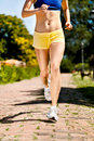 Runner legs in action female Royalty Free Stock Photos