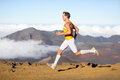Runner man athlete running sprinting fast male sport fitness model training a sprint in amazing nature landscape outdoors at speed Stock Photos