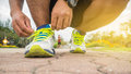 Runner man tying running shoes laces getting ready Royalty Free Stock Photo
