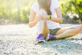 Runner sport knee injury woman in pain while running park Stock Photo