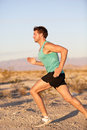 Runner sport man running and sprinting outside training in healthy lifestyle male fitness sports model jogging exercising Stock Image