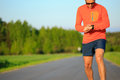 Runner training and checking stopwatch smart watch, cross countr Royalty Free Stock Photo