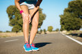 Runner training knee pain female injury and Stock Photos