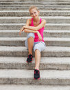 Runner woman have a rest after outdoor workout sport fitness Stock Image
