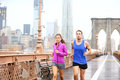 Runners couple running in new york jogging outside rain asian women and caucasian men runner and fitness sport models training Stock Image