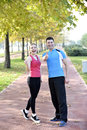 Runners couple sport ok sign running on trail in cross country run outdoors training on jogging track fit young fitness model men Stock Photography