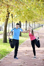 Runners couple sport running on trail in cross country run outdoors training on jogging track fit young fitness model men and Stock Images