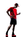 Runners joggers smartphones headphones silhouettes one young man using in isolated on white background Stock Images