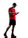 Runners joggers smartphones headphones silhouettes one young man using in on white background Stock Image