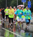 Runners on a rainy, chilly day Stock Image