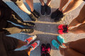 Runners standing in a huddle with their feet together Royalty Free Stock Photo