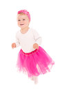 Running baby girl in pink tutu Royalty Free Stock Photo