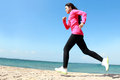 Running on the beach healthy girl in bright sunny day Stock Photo