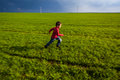 Running boy on green field motion blur Royalty Free Stock Images