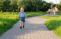 Running boy happily in the park Stock Images