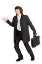 Running a business man in a raincoat Royalty Free Stock Photo