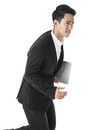 Running businessman with a laptop in hand Royalty Free Stock Images