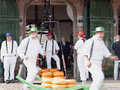 Running cheese bearers at cheese market in alkmaar after weighing are away with the hand barrow filled with gouda the the Stock Photos