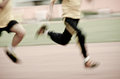 Running child on sport track Royalty Free Stock Photos