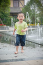 Running chinese boy Royalty Free Stock Photos