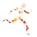 Running fast doping drugs and pills in the shape of an athletic runner on track Royalty Free Stock Photography