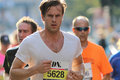 Running focused young man stockholm sep good looking in the half marathon event km sept in stockholm sweden Stock Images