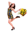 Running girl with basket wild spring flower. Royalty Free Stock Photos
