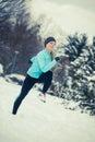 Running girl wearing sportswear, winter fitness Royalty Free Stock Photo
