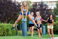 Running girls having fun in the park. Royalty Free Stock Photo