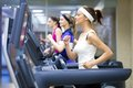Running in gym group of young people on treadmill Stock Image