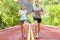 Running health and fitness runners jogging on run training during workout outside on road people together living healthy Royalty Free Stock Image