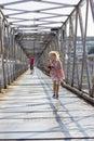Running little girl on pedestrian bridge Royalty Free Stock Photo
