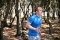 Running man jogging for fitness running in landscape nature outdoors. Royalty Free Stock Photo