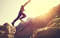 Running Man on Mountains jumping cliff over lake Royalty Free Stock Photo