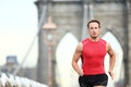Running man sprinting in new york city runner on training run outside caucasian male runner and fitness sport model sprint Royalty Free Stock Photo
