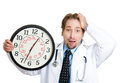 Running out of time closeup portrait an overwhelmed with busy schedule unhappy male health care professional doctor or nurse Stock Photo