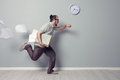 Running out of time stressed business man rushing in the office Royalty Free Stock Photography