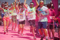 Running people at a color run in cologne event germany will be covered with pink powder Stock Photos