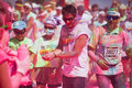 Running people at a color run in cologne event germany will be covered with pink powder Royalty Free Stock Photos