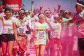 Running people at a color run in cologne event germany will be covered with pink powder Stock Image