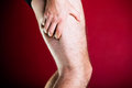 Running physical injury leg pain sport and exercising male runner sore body after Royalty Free Stock Photos