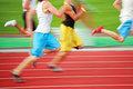 Running the race (motion blur) Royalty Free Stock Image