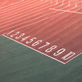 Running race track number screen on ground Royalty Free Stock Photo