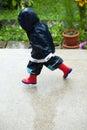 Running in rain Royalty Free Stock Photo