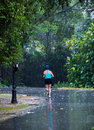 Running in the Rain Royalty Free Stock Image
