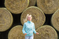 The running romantic girl outdoors against hay stack Royalty Free Stock Photo